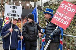 London, UK. 9th January, 2019. A pro-Brexit activist (l) debates with Dr Mike Galsworthy (c) of Scientists for EU and Healthier IN and Steve Bray (r) of SODEM (Stand of Defiance European Movement) alongside College Green on the first day of the debate in the House of Commons on Prime Minister Theresa May's proposed Brexit withdrawal agreement.