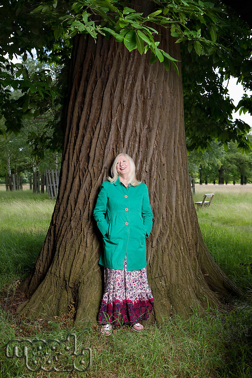 Woman Standing Beneath a Tree