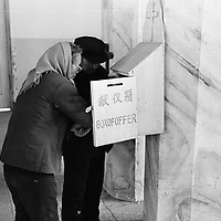 DONGLU, 11 MARCH 2001: members of the congregation empty the donation box after mass.China cut relations with the Vatican in the early fifites and since then, established a Patriotic catholic Church that's controlled by Chinese authorities.<br />Catholics who refused to give up their ties with the Vatican, started worshipping in underground churches and consequently were persecuted for a long time. Since the late nineties though, relations with the Vatican informally started to improve. Although China still has no diplomatic relations, many representatives from official churches met the pope John Paull II secretely . The Vatican, under the pope's leadership, has made several efforts to recover the tie with China. In February 2006 , Hong Kong Bishop Joseph Zen was named one of the first 15 new cardinals, which is seen by many as a gesture of goodwill and a significant step towards recovering the Vatican-China relationship.