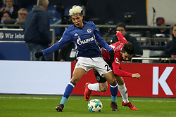 GELSENKIRCHEN, Jan. 22, 2018  Julian Korb (R) of Hannover and Amine Harit of Schalke battle for the ball during the Bundesliga match between FC Schalke 04 and Hannover 96 at Veltins-Arena in Gelsenkirchen, Germany, Jan. 21, 2018. (Credit Image: © Joachim Bywaletz/Xinhua via ZUMA Wire)