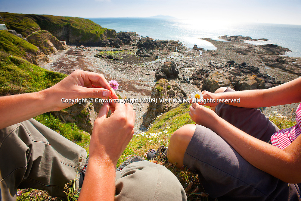 Young couple (man and woman)<br /> Church Bay<br /> Anglesey<br /> North<br /> Walking<br /> Activities &amp; Sports