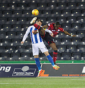 13th February 2018, Rugby Park, Kilmarnock, Scotland; Scottish Premiership football, Kilmarnock versus Dundee; Genseric Kusunga of Dundee battles for the ball with Kris Boyd of Kilmarnock