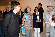 Andy Dewantoro; Angki Purbandono, Indonesian Eye Contemporary Art Exhibition Reception, Saatchi Gallery. London. 9 September 2011. <br /> <br />  , -DO NOT ARCHIVE-© Copyright Photograph by Dafydd Jones. 248 Clapham Rd. London SW9 0PZ. Tel 0207 820 0771. www.dafjones.com.