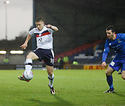 Dundee's John Baird  and Inverness Caledonian Thistle's Ross Draper  - Inverness Caledonian Thistle v Dundee, Clydesdale Bank Scottish Premier League at Tulloch Caledonian Stadium, Inverness.. - © David Young - www.davidyoungphoto.co.uk - email: davidyoungphoto@gmail.com