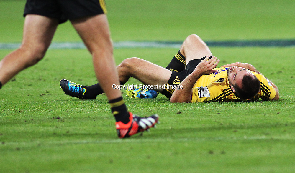 Hurricanes' Conrad Smith lies prone after a heavy clash with Crusaders' Robbie Fruean during Super Rugby match, Hurricanes V Crusaders at Westpac Stadium, Wellington, Friday 8 March 2013. Photo.: Grant Down / photosport.co.nz