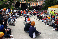 "Rome April 30 2006  .Piazza Vittorio  .Sikh ""Punj Pyare"" (Five Beloved Ones) lead a religious parade.The parade is for Visaki, a traditional Sikh celebration..The lunch."