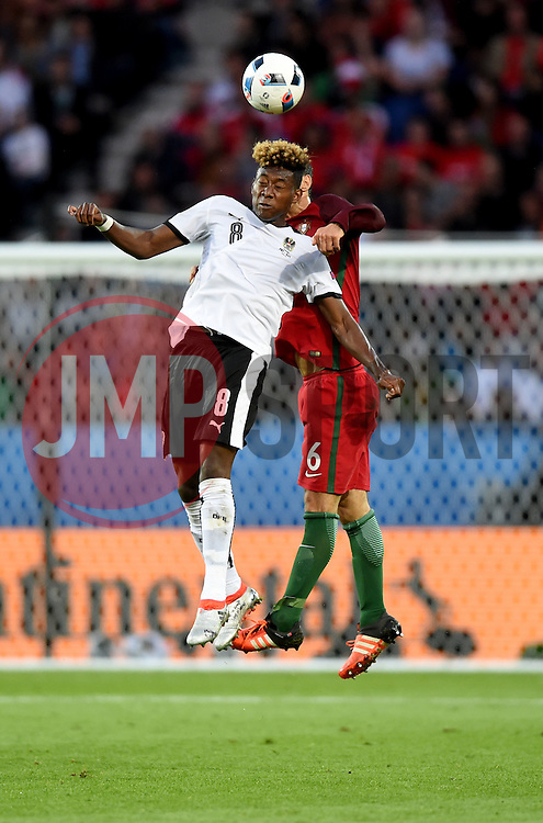 David Alaba of Austria battles for the high ball with Ricardo Carvalho of Portugal  - Mandatory by-line: Joe Meredith/JMP - 18/06/2016 - FOOTBALL - Parc des Princes - Paris, France - Portugal v Austria - UEFA European Championship Group F