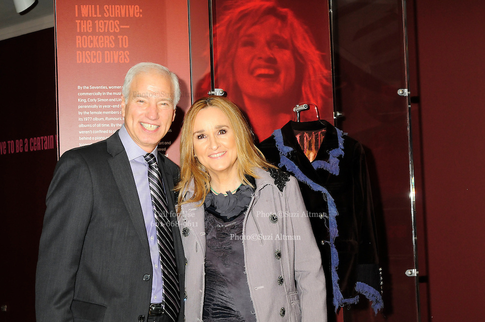 """Melissa Etheridge poses for a photo with Cary H. Sherman Chairman & CEO of the Recording Industry Association of America (RIAA) , in front Etheridges' jacket she wore to the 2005 Grammy Award show. The jacket is part of the """"Women Who Rock"""" exhibition sponsored by the Rock and Roll Hall of Fame and the RIAA (Recording Industry Association of America) at NMWA in Wasington DC. Sunday Nov. 4th. Grammy award winner Melissa Etheridge is presented with The Excellence in the Performing Arts award from the National Museum of Women in the Arts (NMWA) in Washington DC. Sunday Nov. 4, 2012. Etheridge  also performed on the piano and then an acoustic set on guitar for an intimate audience of about 400 people. Photo ©Suzi Altman/For NMWA Grammy award winner Melissa Etheridge is presented with the National Museum of Women in the Arts' (NMWA) Award for Excellence in the Performing Arts in Washington DC. Sunday Nov. 4, 2012. Etheridge also performed on the piano and then an acoustic set on guitar for an intimate audience of about 300 people. Photo ©Suzi Altman/For NMWA<br /> <br /> Melissa Etheridge NMWA Award for Excellence in the Performing Arts"""