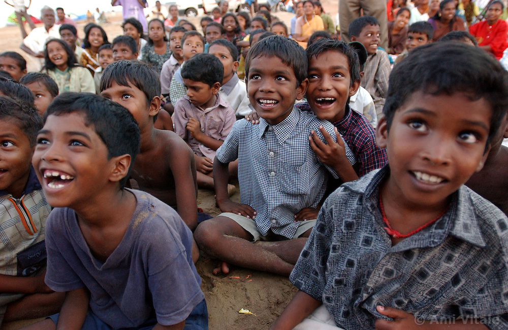 Children watch a puppet show performed by Unicef workers across the bay where all nearly of their homes and boats were destroyed  after the deadly tsunami hit last December 26 in the village of Muzuku Thurai near Cuddalore in Tamil Nadu, India August 26, 2005. Aid agencies  are providing entertainment for children in an effort to help them recover from the severe psycho-social health problems endemic to a catastrophe of this scale. Recovery is slow eight months after the deadly tsunami killed thousands, destroyed homes and livelihoods. The situation is still grim for many who suffer from poor living conditions, depression and many have taken up  alcohol as a means to escape.  (Ami Vitale)