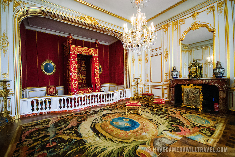 The ornately decorated royal bedroom of Louis XIV at the Chateau de Chambord in the Loire Valley, France.