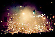 La Nit Magica is a one night event related to Fiestas de la Magdalena festival week in Castell&oacute;n de la Plana, Spain. The &quot;Dimonis&quot; (demons) melt into the crowds and light their sparkles and firecrackers to scare people. This tradition in deeply rooted in the areas of Catalunya, Valencia and the Balears in Spain, as it was firstly documented in the XII century. <br /> <br /> --<br /> <br /> <br /> El correfoc o correfuegos es una manifestaci&oacute;n cultural popular catalana, balear y valenciana, en la que un grupo de personas disfrazadas o no de demonios desfilan por las calles de un municipio corriendo, bailando y saltando entre fuegos artificiales. Desciende de los Ball de diables (bailes de diablos) ya documentado en el siglo XII en Catalu&ntilde;a. Posteriormente ha ido evolucionando hasta el correfoc actual, en la que tiene mucha importancia la pirotecnia. <br /> <br /> La leyenda argumental sobre la cual gira la tradici&oacute;n de els Dimonis ser&iacute;a la de girar el orden establecido. Asi, Lucifer se convierte en el rey de los pobres y desvalidos, que constituye su corte. En este sentido, los oprimidos pasan a ser libres y los opresores, sirvientes.