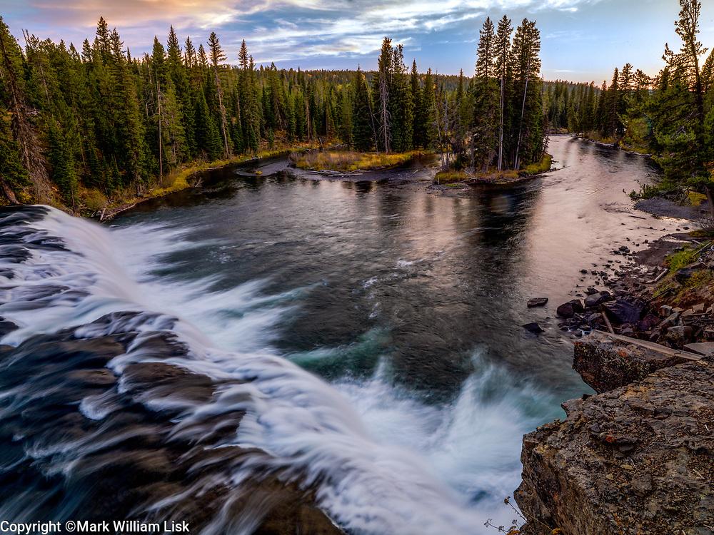 Cave Falls cascades over a sharp basalt ledge, Fall River, Yellowstone National Park.