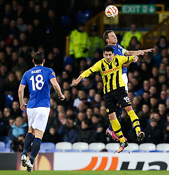 Gonzalo Zarate of BSC Young Boys challenges Everton's Phil Jagielka - Photo mandatory by-line: Matt McNulty/JMP - Mobile: 07966 386802 - 26/02/2015 - SPORT - Football - Liverpool - Goodison Park - Everton v Young Boys - UEFA EUROPA LEAGUE ROUND OF 32 SECOND LEG