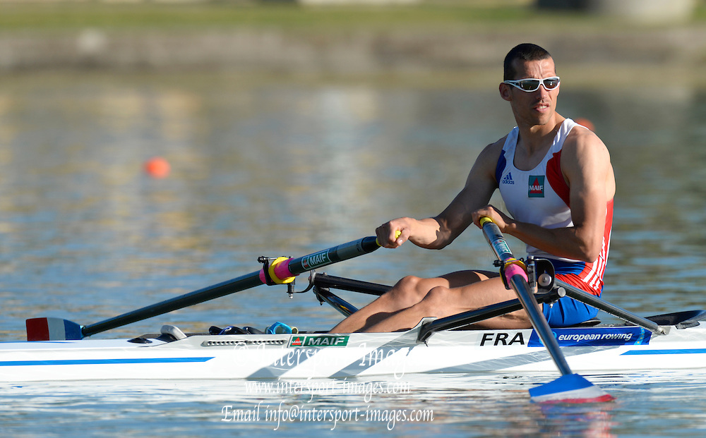 Seville. Andalusia. SPAIN.   FRA LM1X, Maxime GOISSET, moves away from the start pontoon at the 2013 FISA European Rowing Championship.  Guadalquivir River.  Friday   31/05/2013  [Mandatory Credit. Peter Spurrier/Intersport]