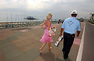 Michael CAMPBELL (NZ) with his wife Julie at home walking by Brighton beach after winning his first major with the US Open trophy he won at Pinehurst,USA during summer at Brighton,East Sussex,England.
