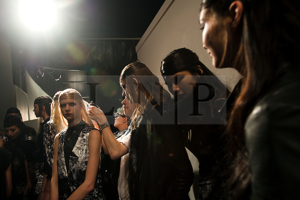 © Licensed to London News Pictures. 21/02/2012. London, UK.  Models Models wait to enter the catwalk for the Aminaka Wilmont Autumn/Winter 2012 collection on day 5 of London Fashion Week 2012, on February 21st, 2012 . Photo credit : Ben Cawthra/LNP