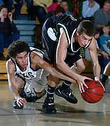 012811-Evergreen, COLORADO-ehsboysbball-Evergreen High School's Andre Lane (No. 10) dives after a loose ball with D'Evelyn High School's Matt Menard (No. 1) during the fourth quarter Friday, January 28, 2011 at EHS. The Jaguars defeated the Cougars, 56-45..Photo By Matthew Jonas/Evergreen Newspapers/Photo Editor