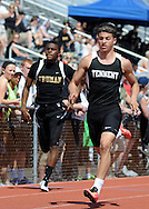 William Tennent's Nik Bank (R) leads Truman's Terez Franklin in the 4x100 relay at the Central Bucks West Relays Saturday April 18, 2015 in Doylestown, Pennsylvania.  (Photo by William Thomas Cain/Cain Images)