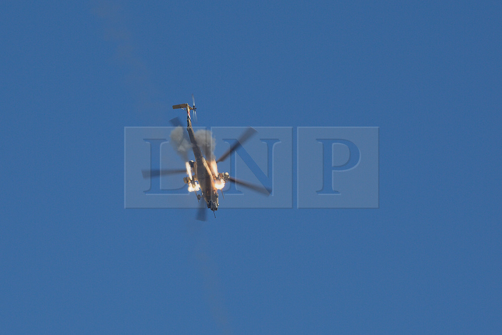 20/02/2017. Albu Saif, Iraq. An Iraqi Army Aviation Mi-28 attack helicopter fires unguided rockets into the village of Albu Saif as Iraqi security forces continue with the offensive to retake western Mosul from Islamic State forces.<br /> <br /> Iraqi forces reported today that one of its attack helicopters, supporting the ongoing Mosul Offensive, was shot down by Islamic State militants.