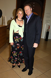 RORY BREMNER and his wife TESSA at a party to celebrate the publication of 'You Are Here' by Rory Bremner, Juhn Bird and John Fortune held at the National Portrait Gallery, St.Martin's Place, London on 1st November 2004.<br />