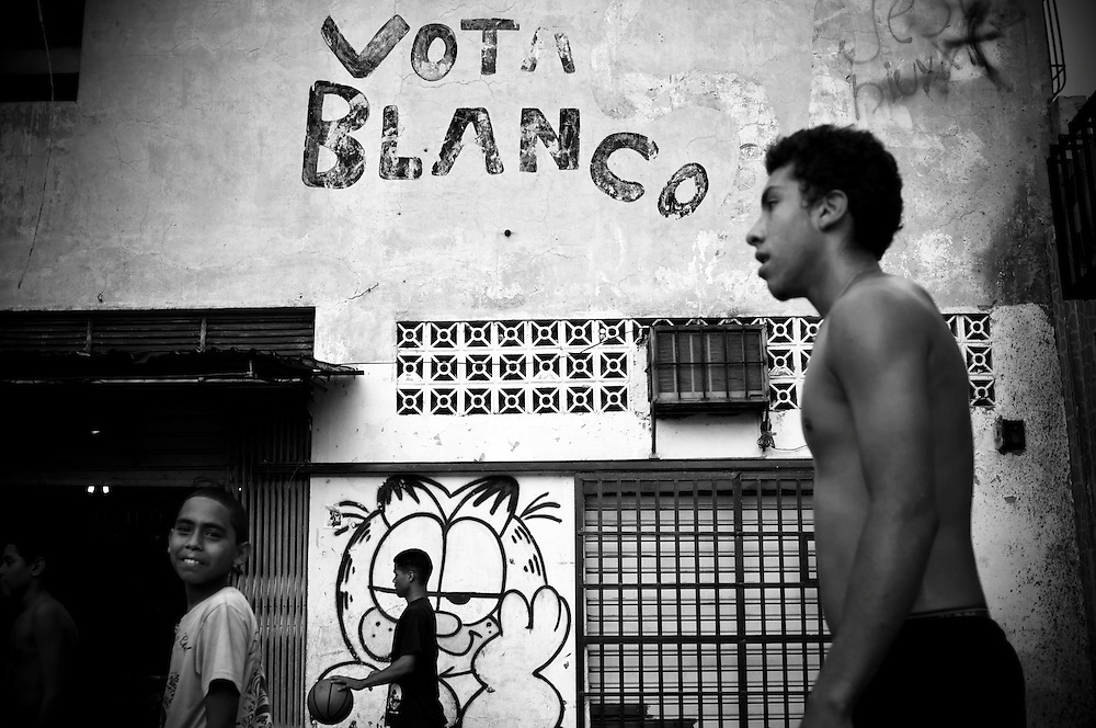 Teenagers play basketball in Buenos Aires, a slum in Caracas, Venezuela. Local newspapers report that dozens of young men are murdered every weekend in Caracas.