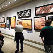 Visitors view Michael Benson's photographic images of Mars at the exhibit, Beyond: Visions of our Solar System, on display at the National Air and Space Museum in Washington DC