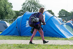© Licensed to London News Pictures. 25/06/2015. Pilton, UK. Festival campsite atmosphere at Glastonbury Festival 2015 on Thursday Day 2 of the festival - new arrivals for today.  This years headline acts include Kanye West, The Who and Florence and the Machine, the latter having been upgraded in the bill to replace original headline act Foo Fighters.   Photo credit: Richard Isaac/LNP