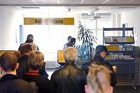 25 MAR 2003, BERLIN/GERMANY:<br /> Arbeitsuchende in einer Warteschlange vor dem Kundenservice, der zu den Beratern weiterleitet oder Formalitaeten erledigt, Arbeitsamt Berlin Mitte, Charlottenstrasse 90<br /> IMAGE: 25032003-01-010<br /> KEYWORDS: Arbeit, work, Arbeitslosigkeit, sign, Arbeistslos