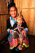 THAILAND, NORTH, GOLDEN TRIANGLE Hmong hilltribe village, grandmother and grandchild, in hills north of Chiang Mai