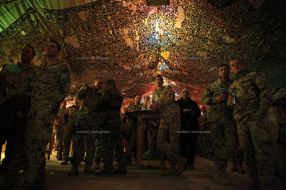 "German soldiers relax at the evening in the ""Beach Club"" called pub inside ISAF Camp Marmal, Mazar-e Sharif, Afghanistan"