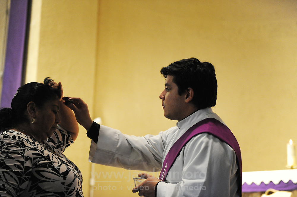 A woman receives her blessing on Ash Wednesday at Sacred Heart in Salinas.
