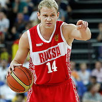10 August 2012: Russia Anton Ponkrashov sets a play as he brings the ball upcourt during 67-59 Team Spain victory over Team Russia, during the men's basketball semi-finals, at the North Greenwich Arena, in London, Great Britain.