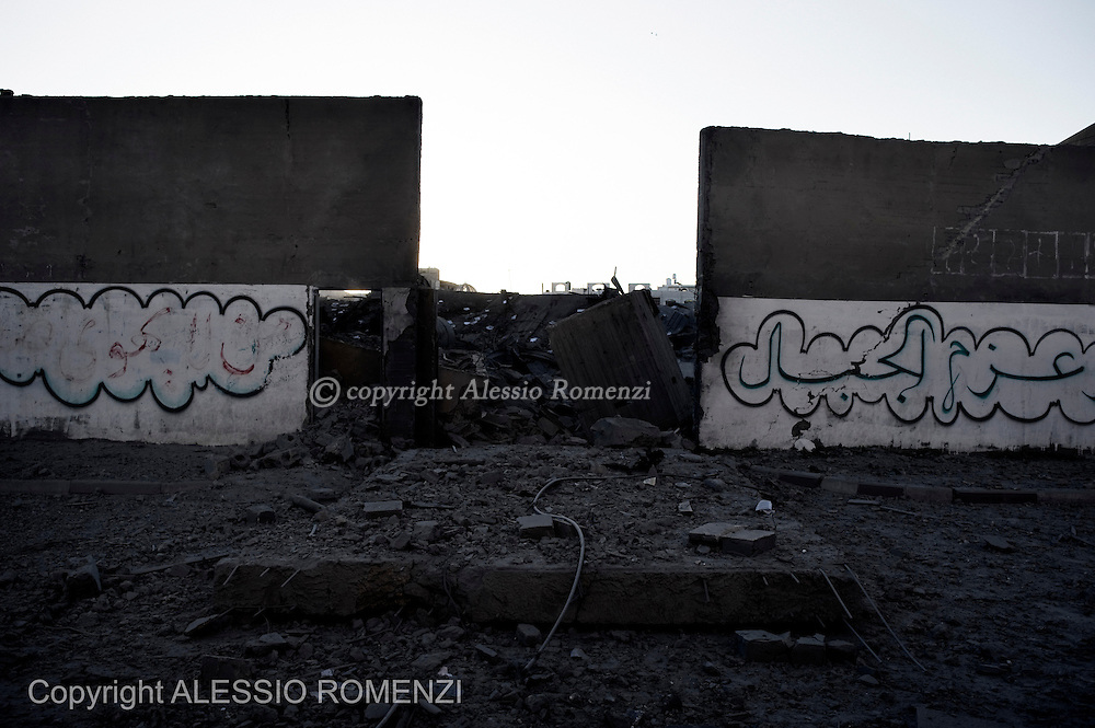 Gaza City: The perimetric wall of the Hamas compound in Gaza. The site was heavily bombed by Israeli Air Force. November 18, 2012. ALESSIO ROMENZI