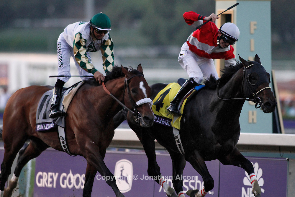 Fort Larned (R) ridden by jockey Brian Hernandez Jr. holds of Mucho Macho Man ridden by Mike Smith to win the Breeders' Cup Classic at the 2012 Breeders' Cup World Championships at Santa Anita Park in Arcadia, CA, November 3, 2012. Jonathan Alcorn/JTA/Uber