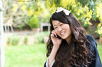 Close up portrait of young woman talking on mobile phone
