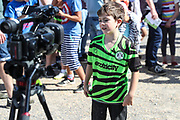 A young FGR fan being interviewed after collecting his free shirt during the EFL Sky Bet League 2 match between Forest Green Rovers and Colchester United at the New Lawn, Forest Green, United Kingdom on 14 September 2019.