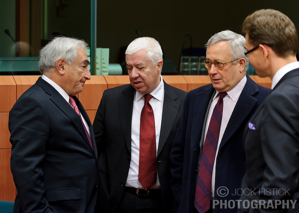 From L to R: Dominique Strauss-Kahn, managing director of the IMF, speaks with Fernando Teixeira Dos Santos, Portugal's finance minister, Giulio Tremonti, Italy's finance minister, and Jyrki Katainen, Finland's finance minister, during a meeting of the Eurogroup finance ministers at the EU Council headquarters in Brussels, Monday, Dec. 6, 2010. (Photo © Jock Fistick)