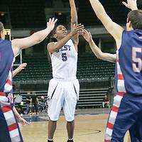 Guard Dexter Walker (5) launches a shot for 2.