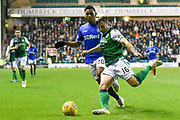16 Lewis Stevenson clears the ball away from Alfredo Morelos during the Ladbrokes Scottish Premiership match between Hibernian and Rangers at Easter Road, Edinburgh, Scotland on 19 December 2018.