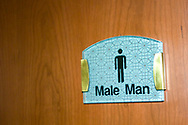 "A humorous sign on a bathroom door reads  ""Male Man"", Shanghai, China."