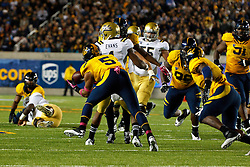 BERKELEY, CA - OCTOBER 06: Defensive back Michael Lowe #5 of the California Golden Bears intercepts a pass intended for wide receiver Shaquelle Evans #1 of the UCLA Bruins during the fourth quarter at California Memorial Stadium on October 6, 2012 in Berkeley, California. The California Golden Bears defeated the UCLA Bruins 43-17. (Photo by Jason O. Watson/Getty Images) *** Local Caption *** Michael Lowe; Shaquelle Evans