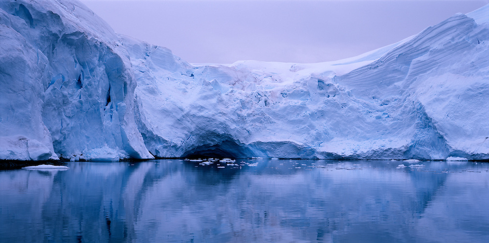 Antarctica, Glacial ice covers mountains on Melchior Islands along Antarctic Peninsula