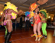 G1FUNN12C<br /> Sakita Jones (center) of Soca Fitness Caribbean Dance limbo dances with her group during the FunTimes Magazine 5th Annual Gala Saturday October 10, 2015 at the Renaissance Hotel in Philadelphia, Pennsylvania. The event featured a dinner dance as well as the recipients of three awards. (William Thomas Cain/For The Inquirer)