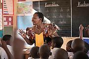 Masasi, Tanzania - 2015-08-10  - Standard 1 teacher Bibie Hassani in class at Mailisita Primary School in Masasi, Tanzania on August 10.   Photo by Daniel Hayduk