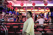 Late night along the infamous Walking Street in Pattaya , prostitutes can be seen entertaining their clients well in to the early hours of the morning. <br /><br /><br />&copy; Giulio Di Sturco<br />Pattay, Thailand 2016