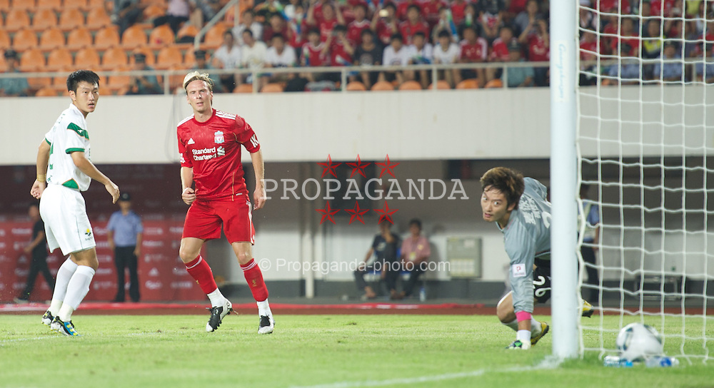 GUANGZHOU, CHINA - Wednesday, July 13, 2011: Liverpool's Christian Poulsen scores the first goal against against Guangdong Sunray Cave during the first pre-season friendly on day three of the club's Asia Tour at the Tianhe Stadium. (Photo by David Rawcliffe/Propaganda)