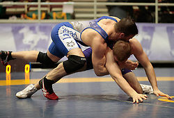 London, Ontario ---2013-03-02---    Kevin Ens of  Western takes on  Chadd Lee of  Lakehead in the men's 90 KG bronze medal match at the 2012 CIS Wrestling Championships in London, Ontario, March 02, 2013. .GEOFF ROBINS/Mundo Sport Images