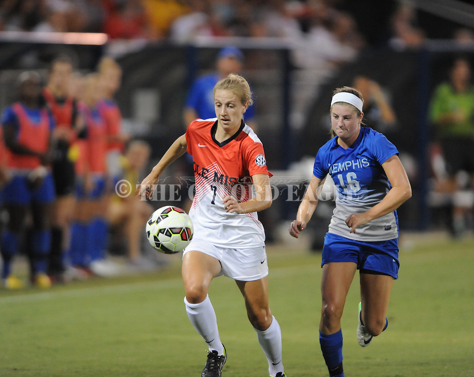 Ole Miss' Bethany Bunker (7) vs. Memphis' Carly Cassady (16) at the Ole Miss Soccer Stadium in Oxford, Miss. on Sunday, September 7, 2014. The match ended in a 1-1 draw.