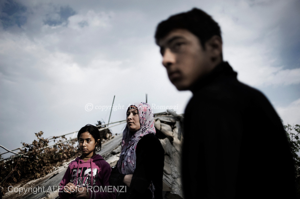 """Gaza Strip: Members of the Palestinian al-Attar family, displaced during the eight-day conflict with Israel, return to their home in the al-Atatra area in the northern Gaza Strip. Their house was bombed four years before too, during """"Cast lead"""" Israeli Defense Force operation. ALESSIO ROMENZI"""