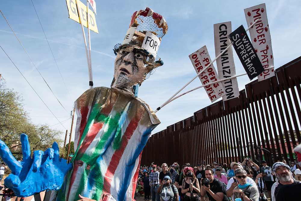 An effigy of Uncle Sam is used during a puppet show illustrating immigration and border politics during a rally along the U.S.-Mexico border in Nogales, Arizona on November 12, 2017. This demonstration was part of a weekend of actions called the SOA Watch Border Encuentro held along the Arizona, U.S.-Sonora, Mexico border region focused on immigrant rights, the demilitarization of the border, and other human rights issues.